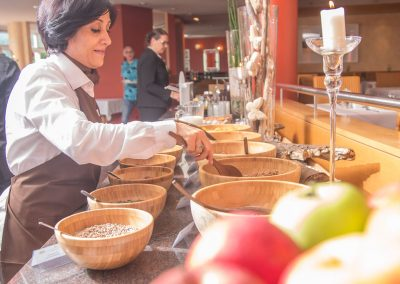 hotel staff preparing the brunch buffet, that is an integral part of the experience at the wellness hotel SCHWARZWALD PANORAMA