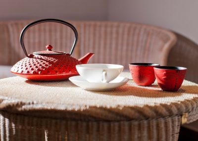 A tea set on a wicker basket, as a part of the interior of the hotel SCHWARZWALD PANORAMA