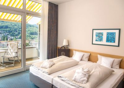 An extraordinary room with a balcony and a panoramic view of the black forest, located in the selfness hotel SCHWARZWALD PANORAMA