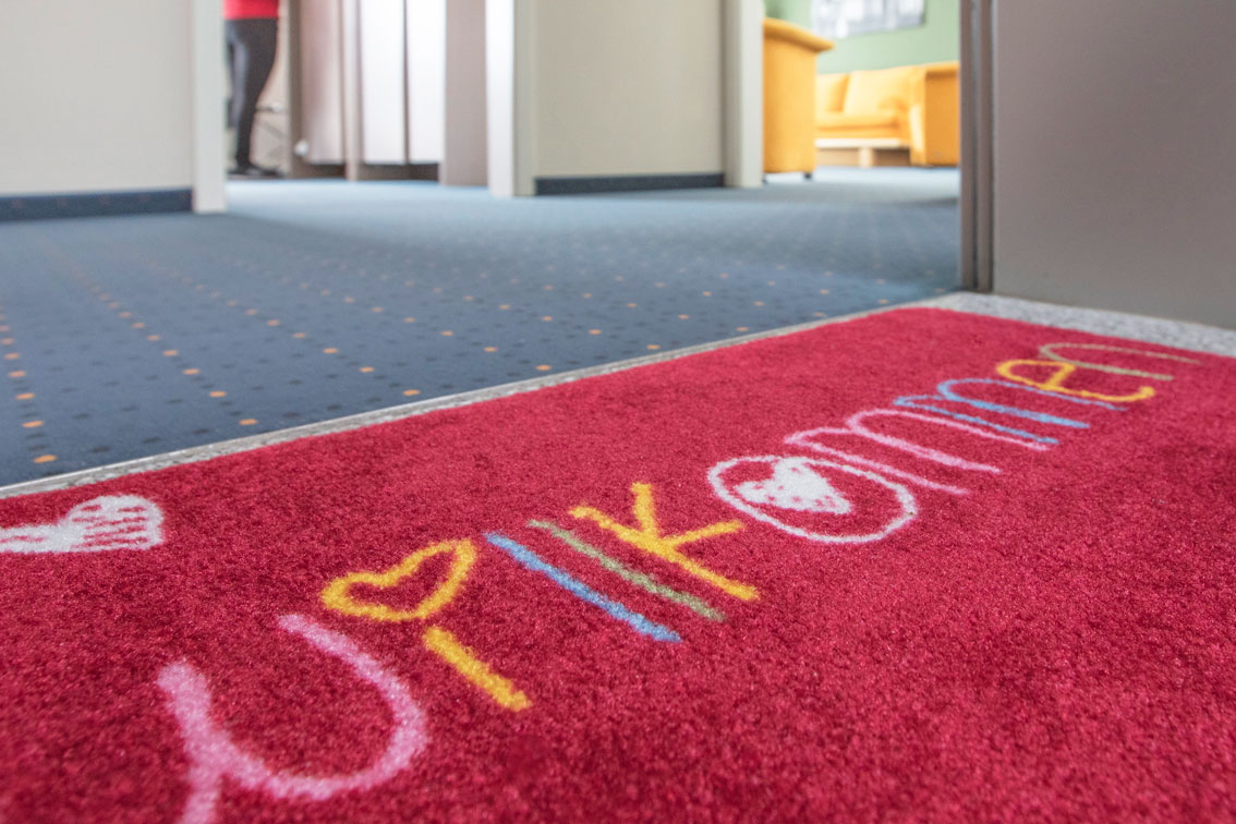 Welcome doormat in the entrance area of an apartment in the Hotel Schwarzwald Panorama
