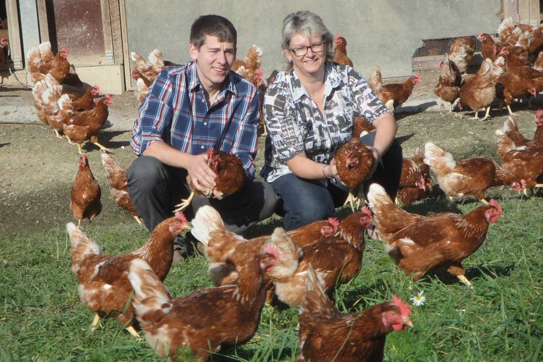 Our partners with their chickens, providing us with organic ingredients for our kitchen.