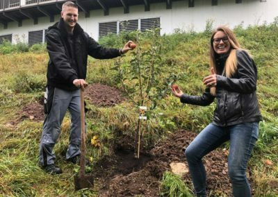 A man and a woman planting a tree, taking action for an active resonance culture